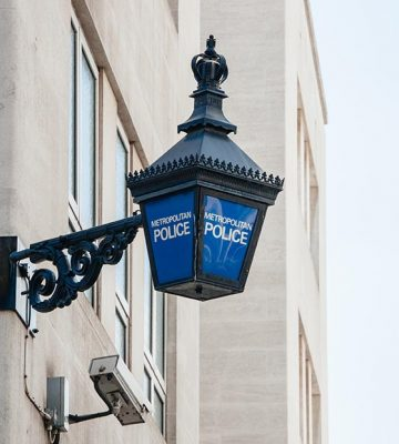 Close-up of a traditional police lantern on display outside a metropolitan police station in the center of London England.